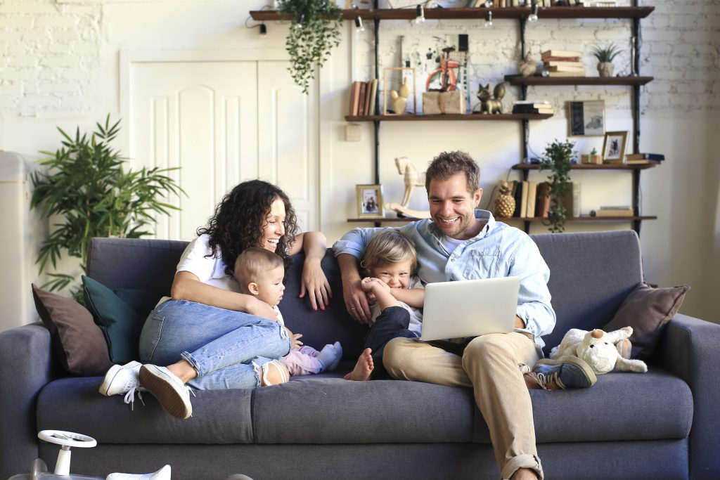 young family browsing homes on a computer