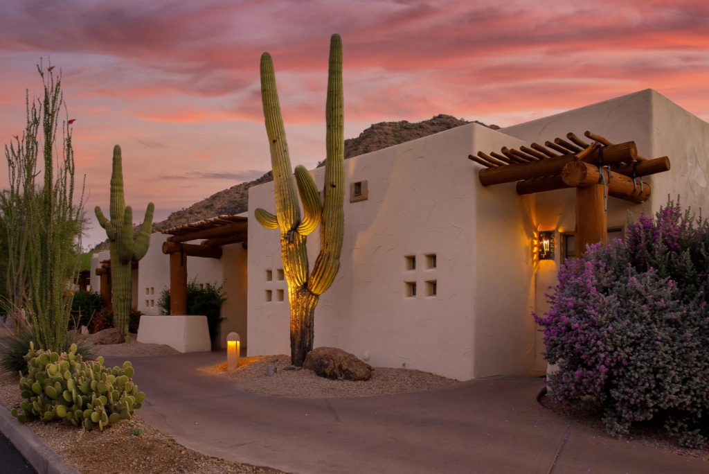 Arizona home with cactus in front of a sunset