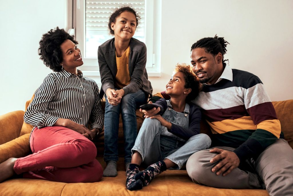 Black family together at home