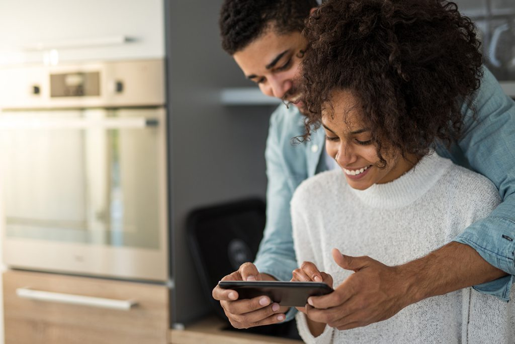 black couple looking at a phone together